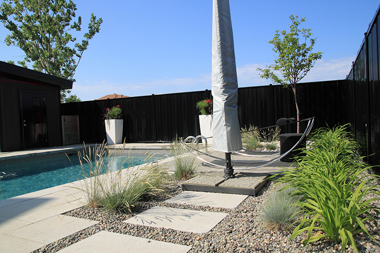 Steep back yard landscaping ideas for Low maintenance pool landscaping